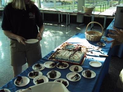 20th Anniversary - Counselor Serves Space Camp Cake