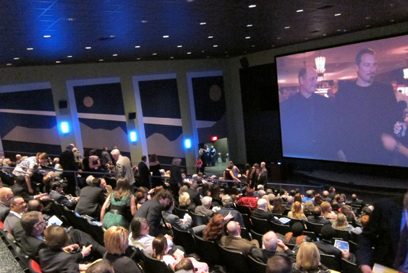 The Audience Takes their Seats while highlights from the LA Premiere Show