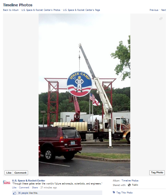 New Logo Sign Going Up on top of Red Gate at Space Camp