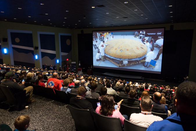 Crowd Gathers in 3D Theatre to Watch Orion