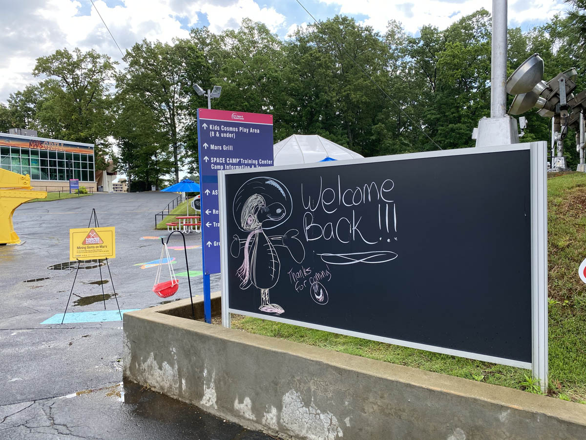 """""""Welcome Back"""" and Snoopy Displayed on Chalkboard in Rocket Park"""